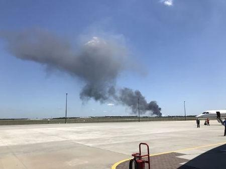 Smoke rises from an airplane crash near Savannah airport, Georgia, U.S., May 2, 2018 in this picture obtained from social media. INSTAGRAM/@PILOTGABE/via REUTERS
