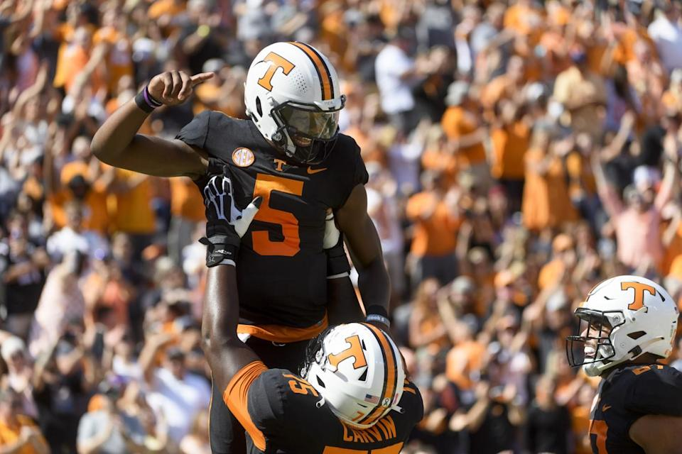 Tennessee quarterback Hendon Hooker is lifted in celebration after scoring a touchdown against South Carolina.