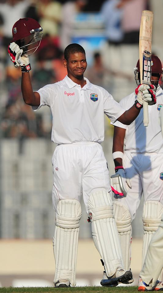 West Indies cricketer Kieran Powell acknowledges the crowd after scoring a century (100 runs) during the fourth day of the first Test match between Bangladesh and The West Indies at the Sher-e-Bangla National Cricket Stadium in Dhaka on November 16, 2012.  AFP PHOTO/ Munir uz ZAMAN