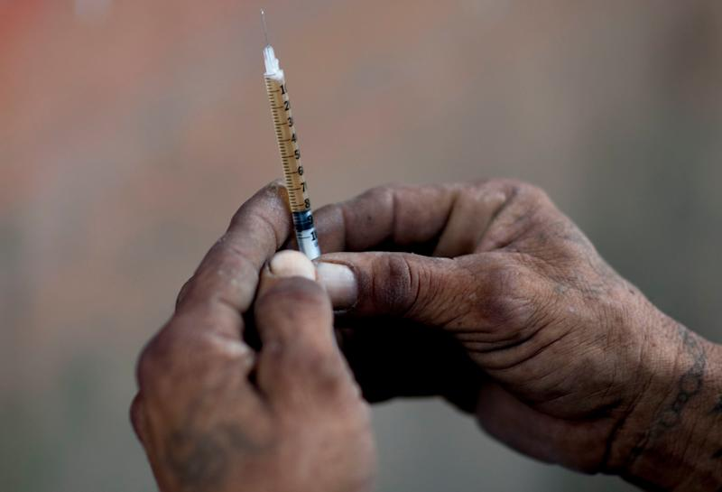 A heroin addict prepares a dose for himself in Humacao, Puerto Rico. Heroin accounted for the second highest number of accidental opioid overdoses in 2017. (Photo: ASSOCIATED PRESS)