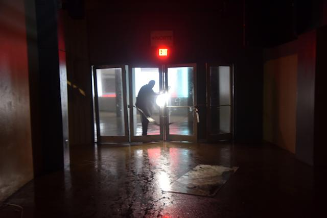<p>A man passes through a door at Roberto Clemente Coliseum in San Juan, Puerto Rico, which suffered damages from wind on September 20, 2017, during the passage of the Hurricane Maria. (Photo: Hector Retamal/AFP/Getty Images) </p>