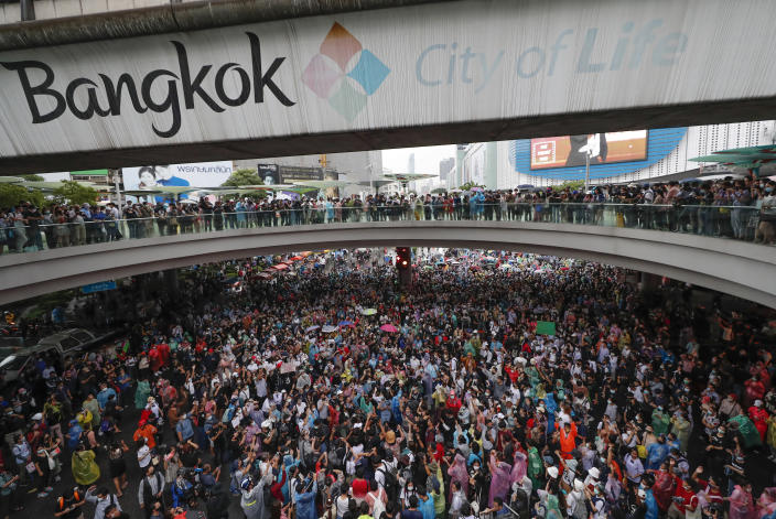 Pro-democracy demonstrators gather in an intersection of a business district in Bangkok, Thailand, Friday, Oct. 16, 2020. Thailand's prime minister has rejected calls for his resignation as his government steps up efforts to stop student-led protesters from rallying in the capital for a second day in defiance of a strict state of emergency. (AP Photo/Sakchai Lalit)