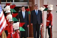 Iraqi Defense Minister Najah al-Shammari, center right, and U.S. Defense Secretary Mark Esper, center left, stand for their country's national anthems during a welcome ceremony at the Ministry of Defense, Baghdad, Iraq, Wednesday, Oct. 23, 2019. Esper has arrived in Baghdad on a visit aimed at working out details about the future of American troops that are withdrawing from Syria to neighboring Iraq. (AP Photo/Hadi Mizban)
