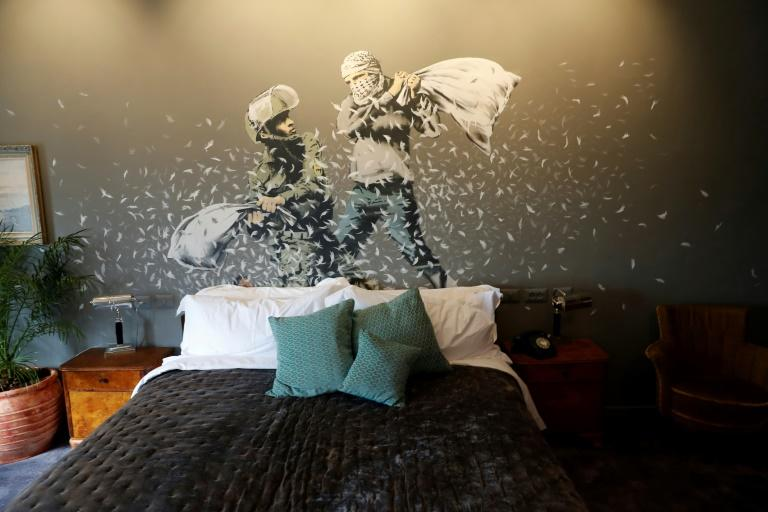 Banksy's newly opened Walled Off hotel in the West Bank town of Bethlehem, has graffiti inside the hotel guest rooms