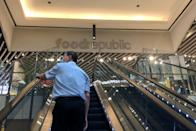 A man wearing a face mask rides the escalator up to the foodcourt in the Somerset 313 mall on 7 April 2020, the first day of Singapore's month-long circuit breaker period. (PHOTO: Dhany Osman / Yahoo News Singapore)
