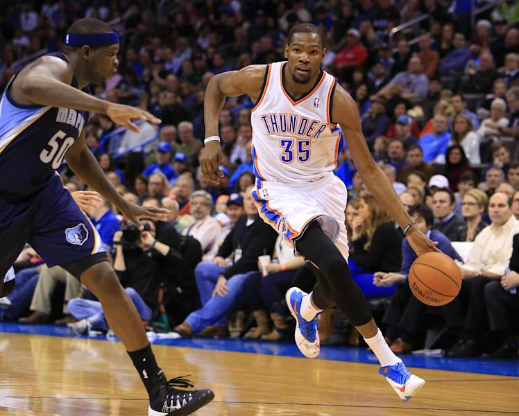 Memphis Grizzlies forward Zach Randolph (50) defends as Oklahoma City Thunder forward Kevin Durant (35) drives to the basket during the third quarter of an NBA basketball game on Monday, Feb. 3, 2014, in Oklahoma City. Oklahoma City won 86-77. (AP Photo/Alonzo Adams)