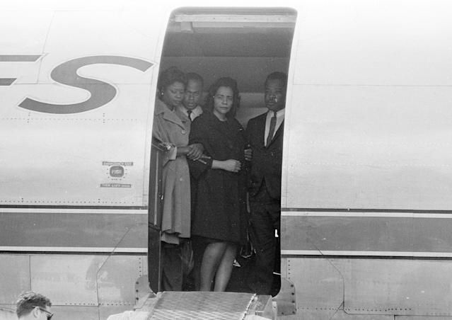<p>Coretta Scott King, center, widow of slain civil rights leader Dr. Martin Luther King Jr., is comforted in the doorway of an airliner in Memphis, Tenn., April 5, 1968, as her husband's body is brought up the ramp. (Photo: AP) </p>