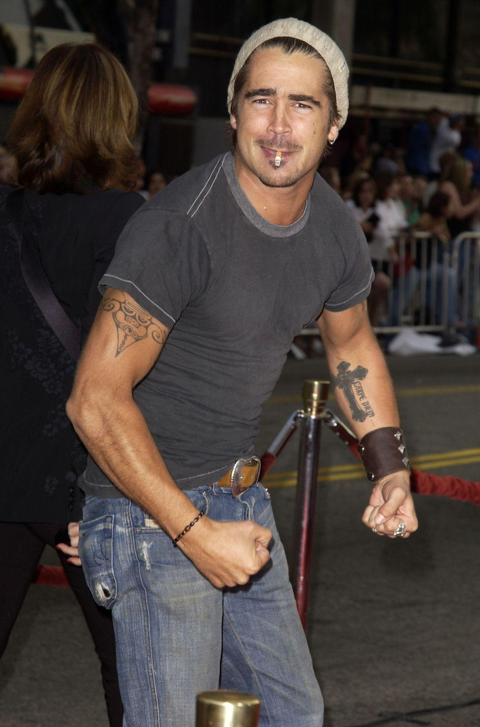 <p>The actor strikes a pose at the premiere of <em>Lara Croft: Tomb Raider</em> in 2003. To top off his bad boy image, Colin Farrell makes sure he shows off his arm tattoos with his pose. </p>