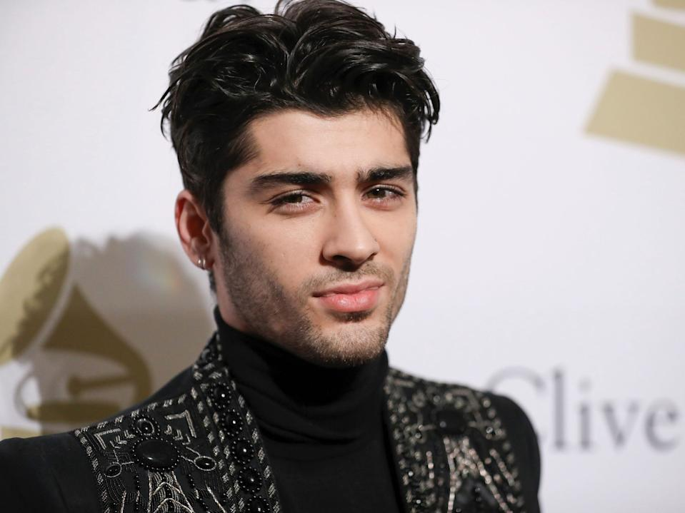 Zayn Malik said Louis Tomlinson told him the plane was going to do a loop-de-loop.