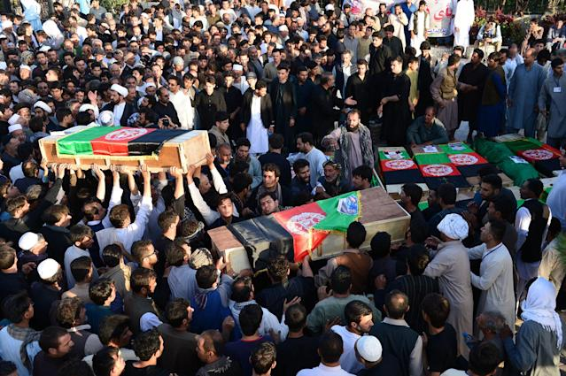 <p>Afghan protesters carry coffins of victims as they shout against the Islamic State group following a mosque attack that killed 33 people in Herat on August 2, 2017. (Photo: Hoshang Hashimi/AFP/Getty Images) </p>