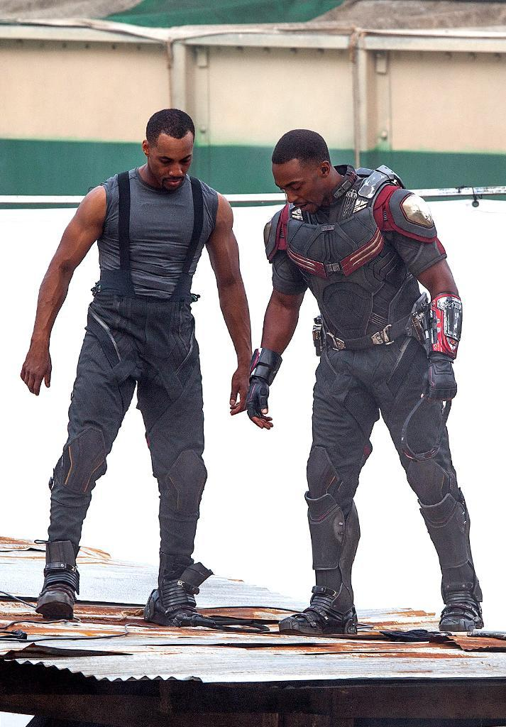 Before he can take wing, Falcon (sans CGI wings) huddles with his stunt double during filming of action sequence on May 15.