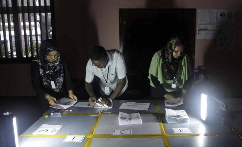 Elections officials count votes after polling for presidential election closed in Male, Maldives, Saturday, Nov. 9, 2013. After two months of political bickering and repeated failure to hold a presidential election, people in the Maldives voted Saturday to elect a new leader for their budding but vulnerable democracy. (AP Photo/Sinan Hussain)