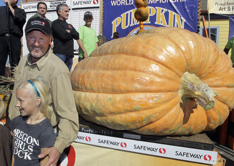 Thad Starr from Pleasant Hill, Ore. celebrates with his daughter Danika, 9, after winning the Half Moon Bay Pumpkin Festival Weigh-off contest in Half Moon Bay, Calif., Monday, Oct. 8, 2012. The pumpkin weighed 1,775 pounds, making it a new California record. Starr wins six dollars for each pound, which equals $10,650. (AP Photo/Tony Avelar)