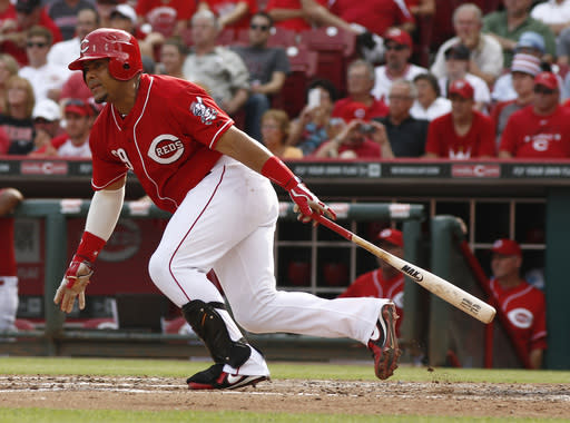 Cincinnati Reds' Brayan Pena watches his RBI-single hit off Washington Nationals starting pitcher Gio Gonzalez in the fifth inning of a baseball game on Saturday, July 26, 2014, in Cincinnati. (AP Photo/David Kohl)
