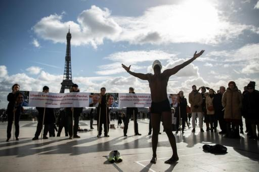 Their supporters have demonstrated in Paris in support of the two academics