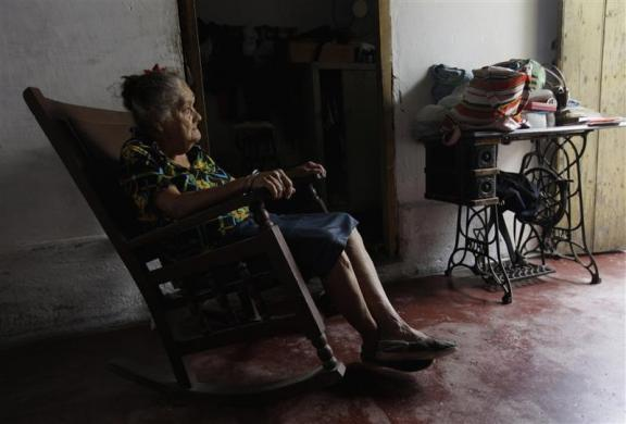 Cleaner Emilia Rodriguez, 78, rests at her home in Havana March 6, 2012.