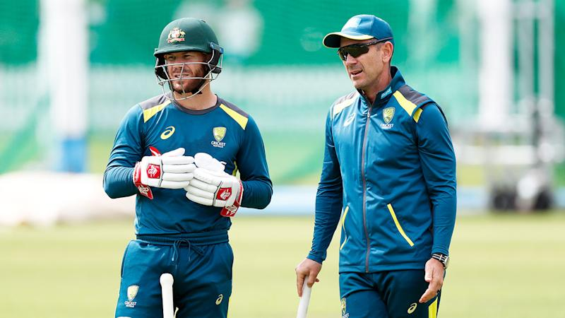 Aussie coach Justin Langer and David Warner at training.