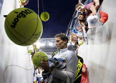 Tennis - Australian Open - Margaret Court Arena, Melbourne, Australia, January 19, 2018. Spain's Rafael Nadal signs autographs after winning his match against Bosnia and Herzegovina's Damir Dzumhur. REUTERS/Toru Hanai