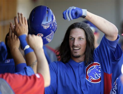 Chicago Cubs' Jeff Samardzija, right, is greeted in the dugout after hitting a solo home run against the Arizona Diamondbacks during the fifth inning of an exhibition spring training baseball game on Monday, March 11, 2013 in Scottsdale, Ariz. (AP Photo/Marcio Jose Sanchez)