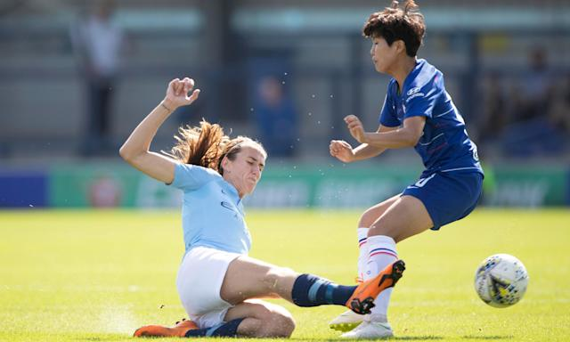 Manchester City's Jill Scott tackles Chelsea's talented South Korean player Ji So Yun.