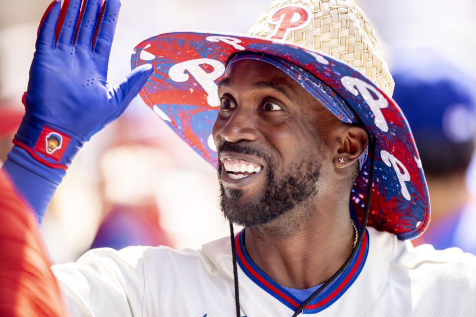 Philadelphia Phillies' Andrew McCutchen celebrates in the dugout after hitting a grand slam home run during the fifth inning of a baseball game against the Washington Nationals, Wednesday, June 23, 2021, in Philadelphia. (AP Photo/Laurence Kesterson)