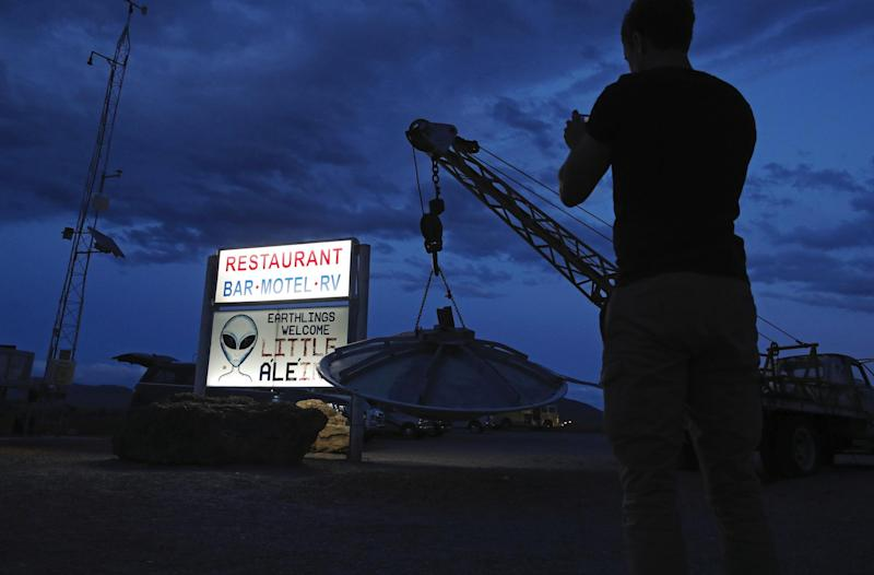 "A man takes a picture of a sign at the Little A'Le'Inn during an event inspired by the ""Storm Area 51"" internet hoax, Thursday, Sept. 19, 2019: AP Photo/John Locher"