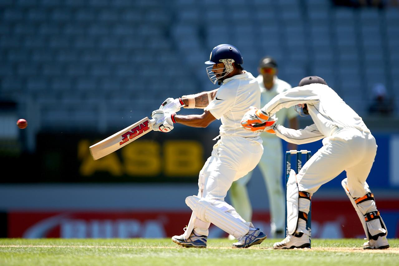 AUCKLAND, NEW ZEALAND - FEBRUARY 09:  Shikhar Dhawan of India bats during day four of the First Test match between New Zealand and India at Eden Park on February 9, 2014 in Auckland, New Zealand.  (Photo by Phil Walter/Getty Images)
