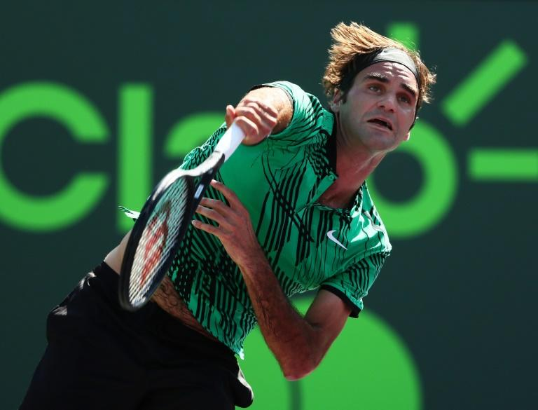 Roger Federer of Switzerland servest against Juan Martin Del Potro of Argentina during their Miami Open 3rd round match, at Crandon Park Tennis Center in Key Biscayne, Florida, on March 27, 2017