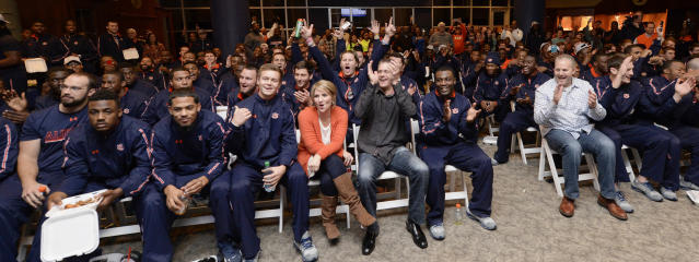 Auburn football team watches BCS Selection Show on Sunday, Dec. 8, 2013 in Auburn, Ala. Auburn coach Gus Malzahn and his wife Kristi are in the center.(AP Photo/Todd J. Van Emst)