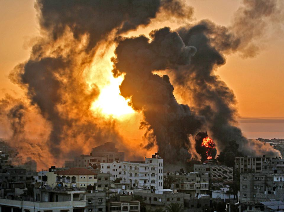 A fire rages at sunrise in Khan Yunish following an Israeli airstrike on targets in the southern Gaza stripYoussef Massoud/AFP via Getty Images