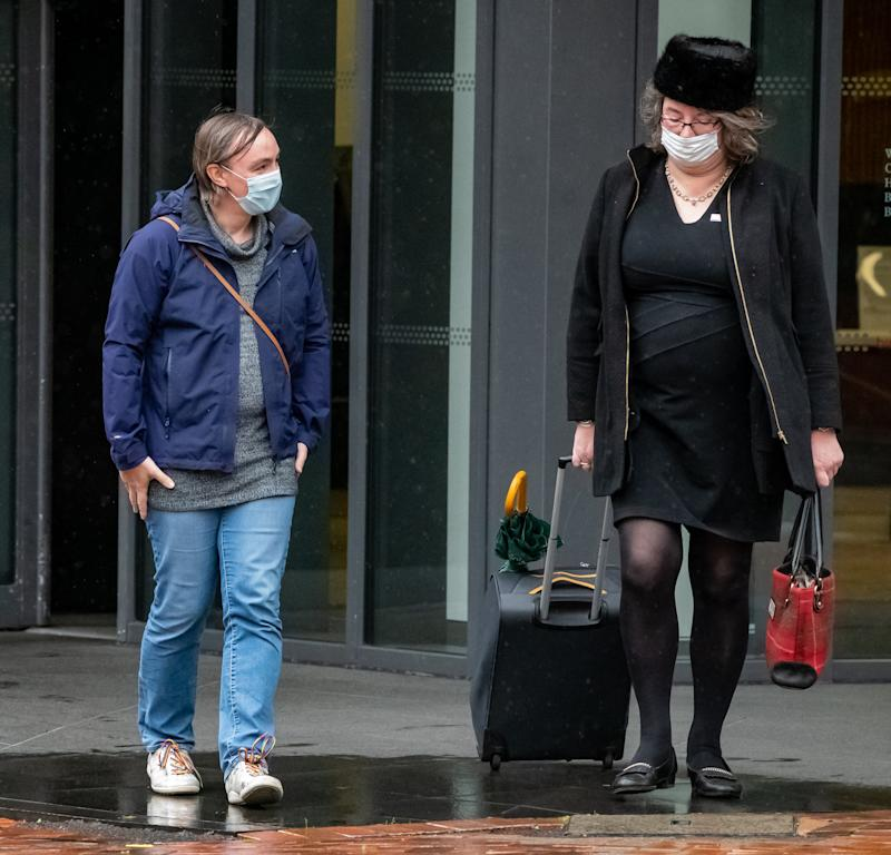 Rose Taylor (L) leaves the Centre City Tower, Birmingham, October 2, 2020. A gender-fluid engineer who was bullied for wearing women's clothes at Jaguar Land Rover has been awarded £180,000 after winning a landmark discrimination case. See SWNS story SWMDgender. Rose Taylor, was teased and harassed by workmates at the car manufacturer after she began identifying as gender fluid/non-binary in 2017. An employment tribunal heard how she suffered insults and abusive jokes at the hands of cruel colleagues and received no support from her management.