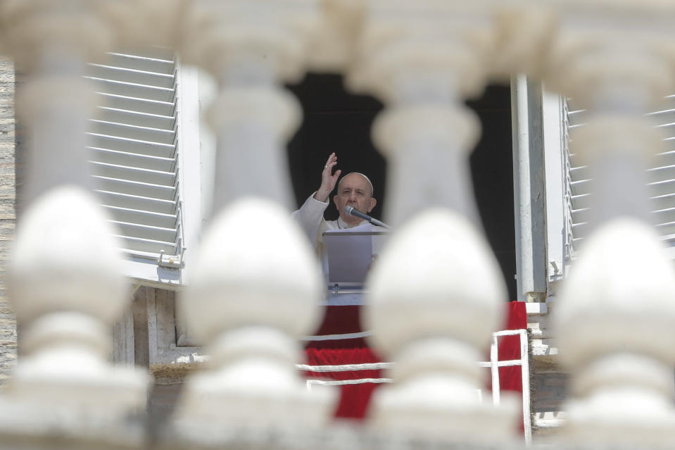 """Pope Francis delivers his blessing as he recites the Angelus noon prayer from the window of his studio overlooking St.Peter's Square, at the Vatican, Sunday, June 7, 2020. Pope Francis is cautioning people in countries emerging from lockdown to keep following authorities' rules for COVID-19 contagion containment. Says Francis: """"Be careful, don't cry victory, don't cry victory too soon."""" (AP Photo/Andrew Medichini)"""