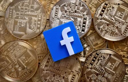 Facebook logo is seen on representations of Bitcoin virtual currency in this illustration picture