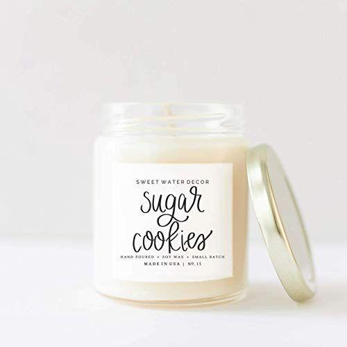 """<p><strong>Sweet Water Decor</strong></p><p>amazon.com</p><p><strong>$20.00</strong></p><p><a href=""""http://www.amazon.com/dp/B077G1SL3N/?tag=syn-yahoo-20&ascsubtag=%5Bartid%7C10050.g.2190%5Bsrc%7Cyahoo-us"""" rel=""""nofollow noopener"""" target=""""_blank"""" data-ylk=""""slk:Shop Now"""" class=""""link rapid-noclick-resp"""">Shop Now</a></p><p>We'd want this burning in our kitchen all year long, whether we're actually baking sugar cookies or not!</p>"""