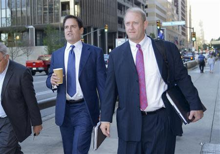 Mark Cuban (L), the billionaire owner of the NBA's Dallas Mavericks, and his attorney Stephen Best (R) approach U.S District Court for the opening day of his insider trading trial in Dallas, Texas September 30, 2013. REUTERS/Tim Sharp