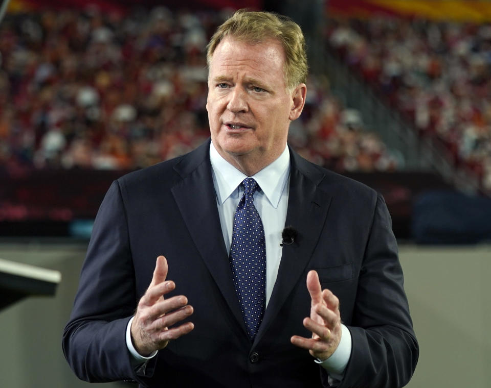 """FILE - In this Feb. 5, 2021, file photo, NFL Commissioner Roger Goodell talks during a ceremony as part of Super Bowl 55 in Tampa, Fla. The NFL is modifying COVID-19 protocols for all personnel who have been fully vaccinated. In a memo sent by Commissioner Roger Goodell to the 32 clubs Friday, April 23, 2021, and obtained by The Associated Press, he cited the """"advice of our medical and scientific experts"""" for the agreement to modify protocols to """"reflect the reduced risk of infection and transmission for fully vaccinated individuals."""" (AP Photo/Charlie Riedel, File)"""