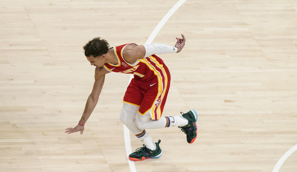 Atlanta Hawks guard Trae Young (11) celebrates after shooting and scoring against the New York Knicks during the second half in Game 3 of an NBA basketball first-round playoff series Friday, May 28, 2021, in Atlanta. (AP Photo/Brynn Anderson)