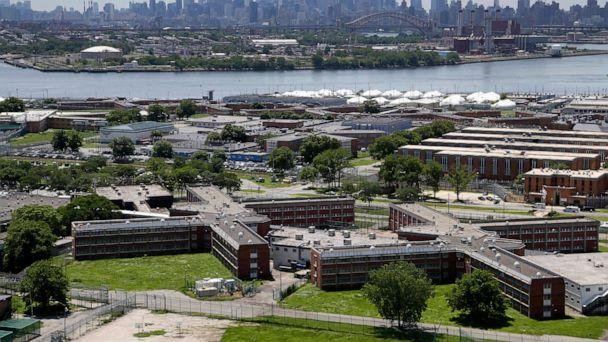 PHOTO: In this June 20, 2014, file photo, the Rikers Island jail complex stands in New York is shown with the Manhattan skyline in the background. (Seth Wenig/AP, FILE)