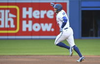 Toronto Blue Jays' George Springer rounds the bases after hitting a solo home run against the Cleveland Indians during the first inning of a baseball game Wednesday, Aug. 4, 2021, in Toronto. (Jon Blacker/The Canadian Press via AP)