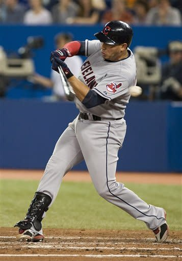 Cleveland Indians' Asdrubal Cabrera strikes out against the Toronto Blue Jays during third inning of a baseball game in Toronto, Sunday, July 15, 2012. (AP Photo/The Canadian Press, Aaron Vincent Elkaim)