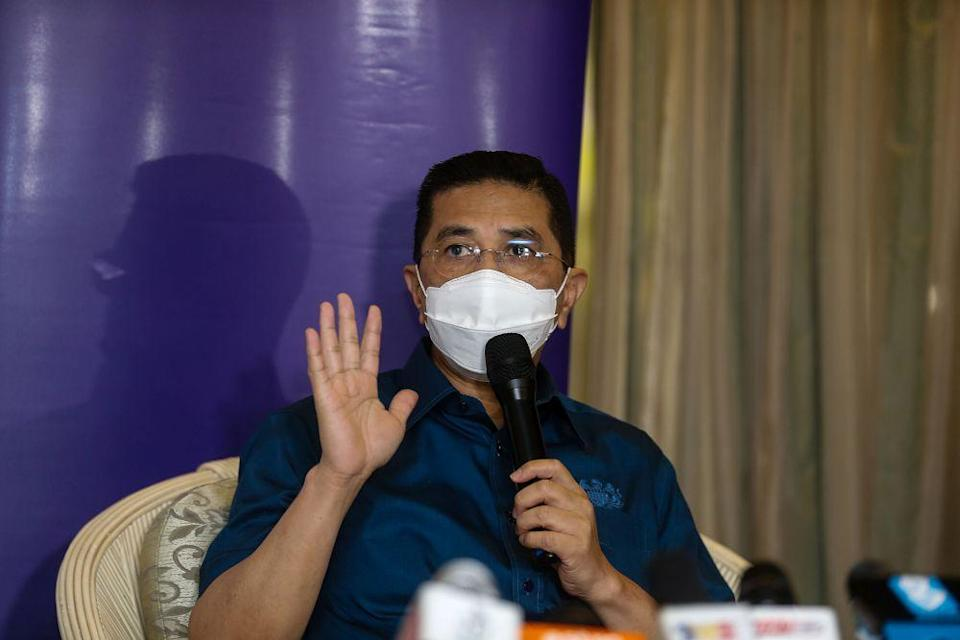Minister of International Trade and Industry Datuk Seri Azmin Ali speaks to the press during a visit to the Bukit Jawi Golf Resort vaccination centre in Penang June 17, 2021. — Picture by Sayuti Zainudin