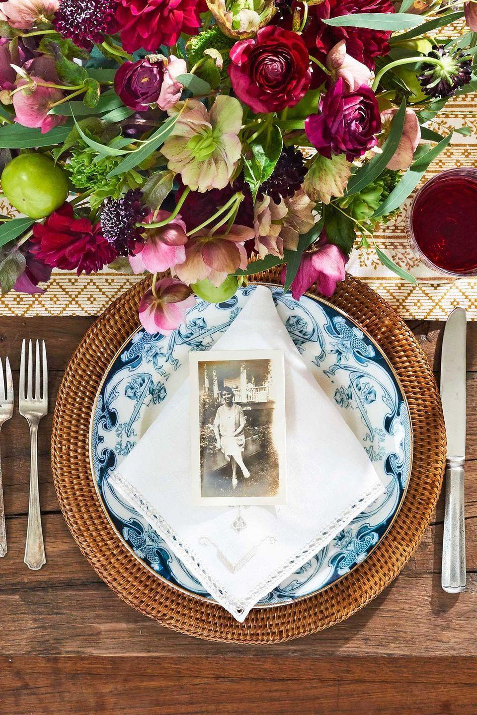 "<p>When it comes to your Thanksgiving <a href=""https://www.countryliving.com/entertaining/g1219/fall-dinner-party"" rel=""nofollow noopener"" target=""_blank"" data-ylk=""slk:table decor"" class=""link rapid-noclick-resp"">table decor</a>, beauty and elegance matters—but so does a homey sense of family. This inspired idea calls for using old family photos to help guests find their seats. It's bound to be an excellent conversation starter too.</p><p><a class=""link rapid-noclick-resp"" href=""https://www.amazon.com/Artifacts-Trading-Company-Rattan-Charger/dp/B00O8ZJR0M?tag=syn-yahoo-20&ascsubtag=%5Bartid%7C10050.g.1538%5Bsrc%7Cyahoo-us"" rel=""nofollow noopener"" target=""_blank"" data-ylk=""slk:SHOP WOVEN CHARGERS"">SHOP WOVEN CHARGERS</a></p>"