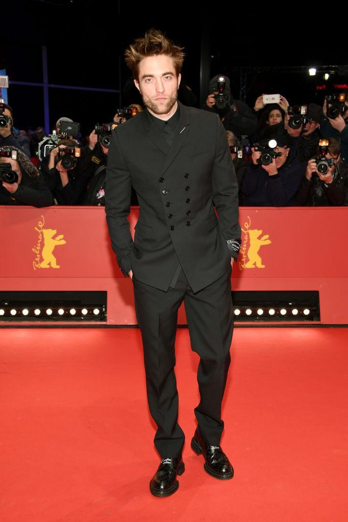 <p>Robert Pattinson looked dashing in a double-breasted suit for the premiere of 'Damsel' during Berlin Film Festival. <em>[Photo: Getty]</em> </p>