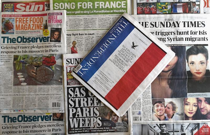 British newspapers on November 15, 2015 shows front pages dominated by reports on the wave of terror attacks in Paris which took place on the evening of November 13 (AFP Photo/Daniel Sorabji)