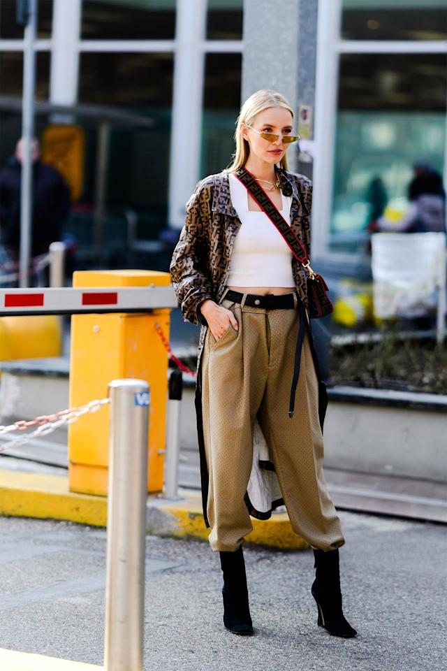 <p>For a chic way to show off your footwear, tuck a pair of trousers into the tops of your boots. </p>