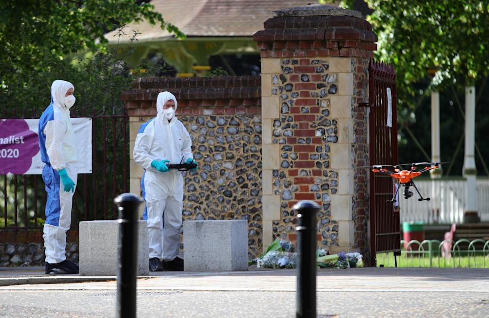 Forensic police fly a drone at Forbury Gardens, in Reading town centre, the scene of a multiple stabbing attack which took place at around 7pm on Saturday leaving three people dead and another three seriously injured.