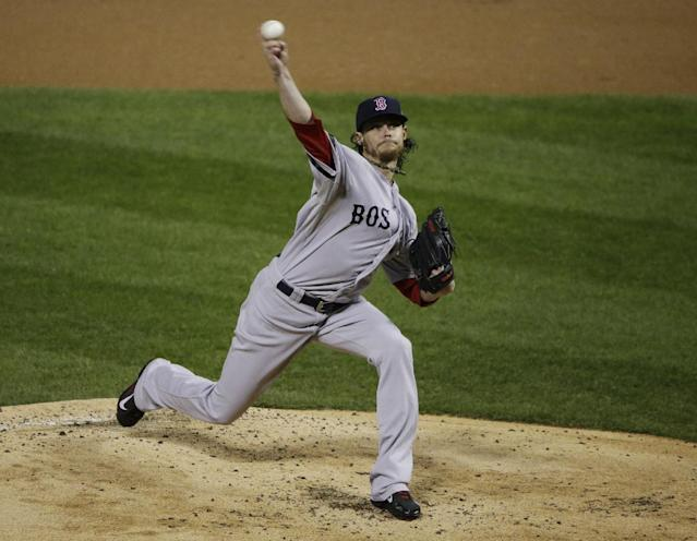 Boston Red Sox starting pitcher Clay Buchholz throws during the first inning of Game 4 of baseball's World Series against the St. Louis Cardinals, Sunday, Oct. 27, 2013, in St. Louis. (AP Photo/Charlie Neibergall)