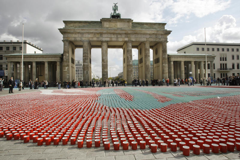 FILE - In this Monday, Sept. 29, 2008 file photo, 77,000 cups sit in front of the Brandenburg Gate in Berlin for use in a television show to illustrate how many cups of coffee the average German drinks during their lifetime. A large U.S. federal study concludes people who drink coffee seem to live a little longer. Researchers saw a clear connection between cups consumed and years of life. Whether it was regular or decaf didn't matter. The results are published in the Thursday, May 17, 2012 New England Journal of Medicine. (AP Photo/Herbert Knosowski)