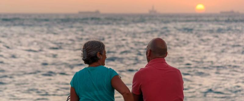 Oranjestad, Aruba - January 8, 2018: A couple admire a romantic sunset in Oranjestad.