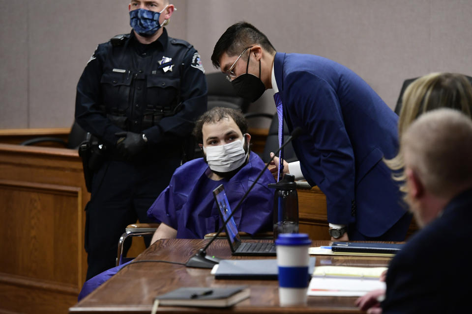 """FILE - In this Thursday, March 25, 2021 file photo, Ahmad Al Aliwi Alissa, 21, appears before Boulder District Court Judge Thomas Mulvahill at the Boulder County Justice Center in Boulder, Colo. On Friday, March 26, 2021, The Associated Press reported on a manipulated image circulating online incorrectly asserting that CNN displayed a banner during coverage of the mass shooting in Boulder, Colorado, stating the gunman was """"factually Arab, but morally white."""" The manipulated screenshot of a CNN broadcast was shared thousands of times on Facebook this week, fooling social media users who did not realize it was initially shared as satire. (Helen H. Richardson/The Denver Post via AP, Pool)"""